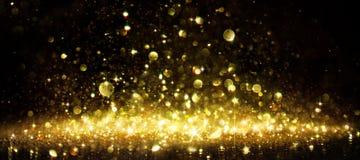 Shimmer Of Golden Glitter. On Black Stock Image