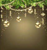 Shimmering Background with Fir Branches and Golden Christmas Balls Royalty Free Stock Photo