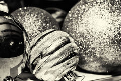 Shimmering christmas baubles, black and white Royalty Free Stock Photos