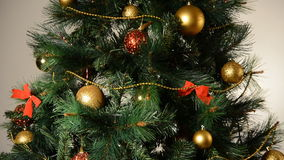 Shimmering Christmas tree with toys. stock footage
