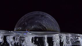 Color of bubble soap on ice sheet. Shimmering color of bubble soap on ice sheet. concept scientific experiment stock footage