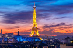 Shimmering Eiffel Tower at sunset in Paris, France Stock Photos