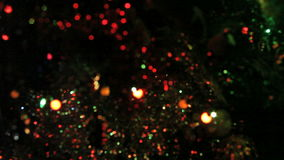 Shimmering  garland on a Christmas tree stock footage