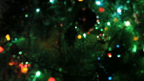 Shimmering  garland on a Christmas tree stock video