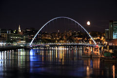 Shimmering Lights. Evening on the Tyne. The Gateshead Millennium Bridge lit with spotlights Stock Images
