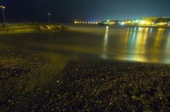 Shimmering lights of night sky over Black Sea. Shimmering lights of a city reflecting over Black Sea at Olimp resort Romania Stock Images