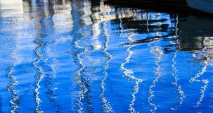 Shimmering masts in watery view Stock Images