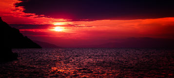 Shimmering rubies. Sea sunset in deep red toes Stock Photo