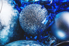 Shimmering shiny Christmas balls on the Christmas tree. Christmas ball with blue sparkles Royalty Free Stock Image