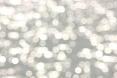 Shimmering sunlight blurred bokeh background. Shimmering sunlight touches ocean in blurred background stock photography