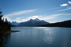 Shimmery Lake with Mountain in Background Royalty Free Stock Photos