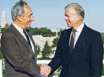 Shimon Peres Greets Jimmy Carter i Jerusalem Royaltyfri Foto