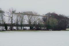 Shimpling Suffolk i snön arkivbild