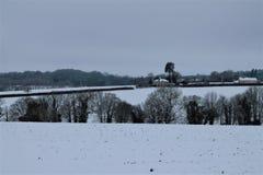 Shimplings-Suffolk im Schnee stockbilder