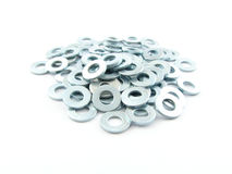 Shims. A pile of silver shims isolated on a white background Stock Photography