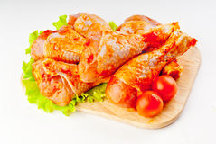 Shin of a chicken in marinade Royalty Free Stock Photo