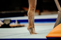 Shin female gymnast in taping. Standing on her toes royalty free stock photography