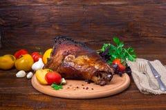 Shin, knee wild boar - roast pork leg with vegetables Stock Photo