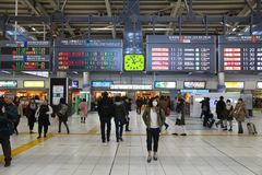 Shinagawa Station. TOKYO, JAPAN - DECEMBER 3, 2016: Passengers hurry in Shinagawa Station in Tokyo. The station was used by 335,661 passengers daily in 2013 Stock Images