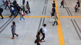 Shinagawa,Tokyo,Japan. Tokyo,Japan - April 26:People walking through the busy Shinagawa train station in Tokyo on April 26, 2014.Shinagawa station is one of the stock footage
