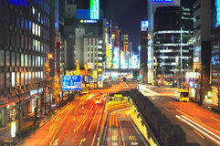 Shinbashi , Tokyo, Japan. Rush hours in Tokyo . The picture shows cars moving very fast. Neon lighting and car headlamps provide a unique lighting scenario Stock Photography