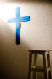 Shine on cross. Shine on blue cross in the room Stock Photography