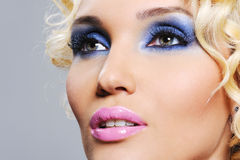 Shine glamour make-up. Bright shine glamour make-up on the young beautiful female face Royalty Free Stock Photos