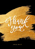 Shine Gold Foil Thank You Card. Calligraphy. On Black Background. Thank You Hand lettering handmade vector calligraphy Stock Photo