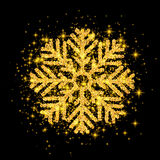 Shine Golden Snowflake covered with Glitter on Black Background. Gold Snow. Luxurious Christmas Design Element, decoration shining sparkling light effect Royalty Free Stock Photo