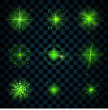 Shine green stars glitters sparkles. Green shine stars with glitters, sparkles icons set. Effect twinkle, glare, scintillation element sign, graphic light Royalty Free Stock Photography