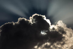 Shine of Hope. Sun disappearing behind the clouds Royalty Free Stock Photography