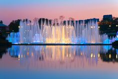Shined fountain on sunset Stock Images