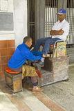 Shiner and his client in the old habana, cuba. royalty free stock photography