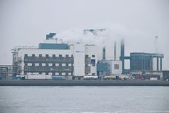 Shinetsu PVC chemical factory in the botlek harbor in Rotterdam in the Netherlands along riverside Nieuwe Waterweg. Shinetsu PVC chemical factory in the botlek royalty free stock photo