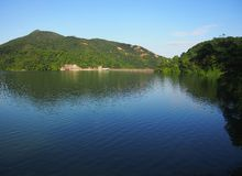Shing Mun Reservoir. Reflection of mountains in Shing Mun Reservoir in Hong Kong China. The Reservoir also known as Jubilee Reservoir was built to meet the Royalty Free Stock Photos