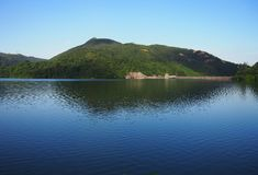 Shing Mun Reservoir. Reflection of mountains in Shing Mun Reservoir in Hong Kong China. The Reservoir also known as Jubilee Reservoir was built to meet the Royalty Free Stock Images