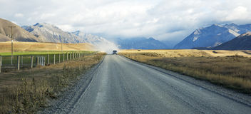 Shingle Back Road with Vehicle, Otago, New Zealand Royalty Free Stock Images