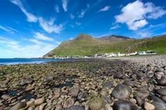 Shingle beach of Famjin, Suduroy, Faroe Islands. Faroe Islands coastal landscape . Shingle beach of Famjin, a village on the sea surrounded by unspoilt nature Stock Image