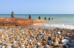 Shingle beach and groyne in England Stock Photos