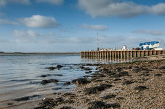 Shingle beach and jetty Stock Photos