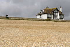 Shingle beach and old cottage at New Romney Royalty Free Stock Photos