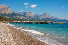 Shingle beach and sea view in Kemer, Turkey. Stock Images