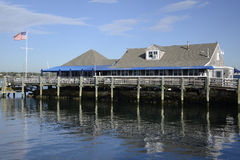 Shingle building by water and dock Royalty Free Stock Photos