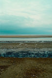 Shingle rocky beach of Northern Sea, Holkham beach, United Kingdom Stock Photo