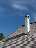 Shingle roof, with chimney and moon Stock Image