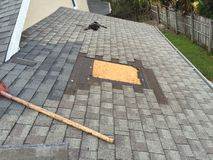 Shingle Roof Roofing Repairs, roofer, tools Royalty Free Stock Photo