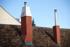 Shingle roof with two chimneys Stock Photography