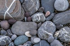 Shingle shore, closeup, clean beach, rocks Crimea Royalty Free Stock Photography