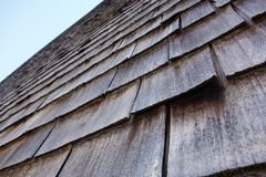 Shingle wooden facade or roof in austria Royalty Free Stock Photos