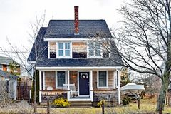 Shingled Beach Cottage with Front Porch stock image